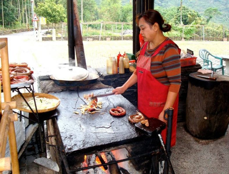 Taiwan Food - This Rukai lady is grilling sausages on a slate slab, a traditional aboriginal way of cooking meats.